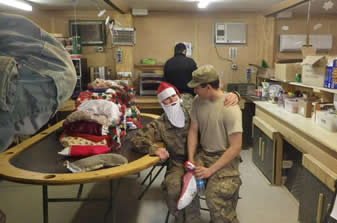 soldier sitting on santa soldier's lap